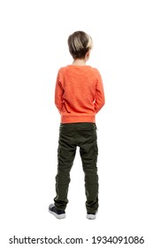 A 9-year-old boy stands in jeans and an orange sweater. Full height. Isolated on a white background. Vertical. Back view.