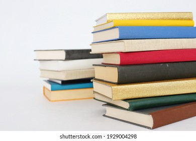 _Stack of books on white background