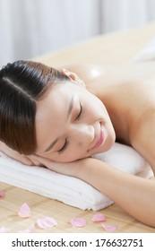 A young woman enjoying massage