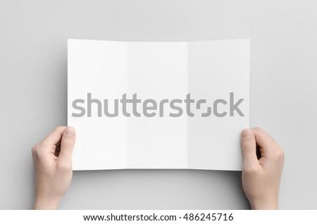 a 4 tri fold brochure mock up male hands の写真素材 今すぐ編集