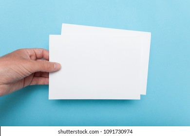 A5 Flyer mockup in hand, paper blank template brochure.