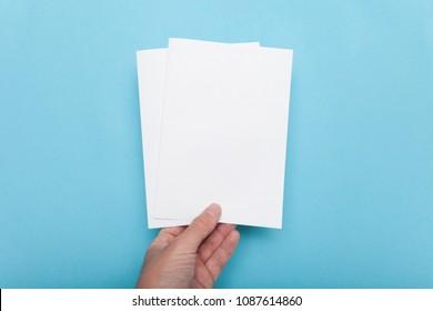 A5 flyer mockup paper brochure in hand.