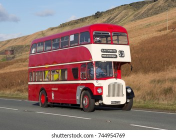 THE A62 NEAR MARSDEN, YORKSHIRE, ENGLAND, OCTOBER 20 2017. A vintage 1966 Daimler CVG6LX  preserved double decker bus on a scenic run on a moorland road