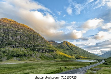 A82 highway runs through Glecoe with Loch Achtriochtan in the distance and mountains Aonach Dubh and An T-sron in Scotland.