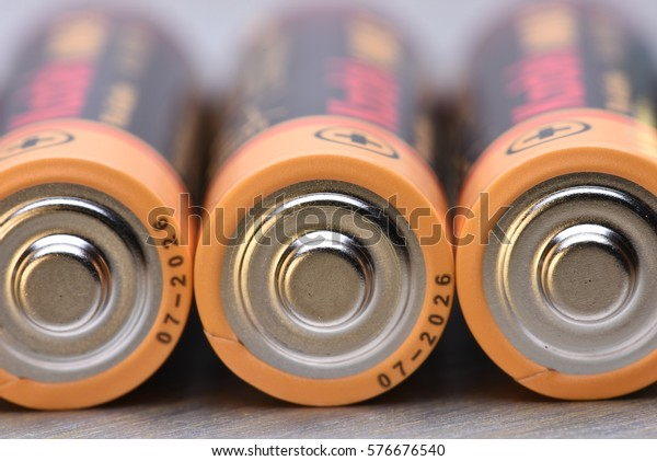 AA Batteries Closeup on Metal Background