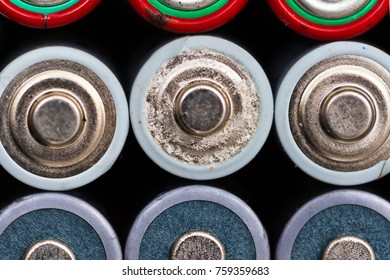 AA empty batteries group on black background