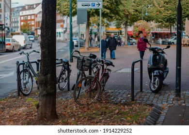 Aachen, Germany - 13.10.2016 : Bicycle parking in the street. There are 3 bicycles and one moped.