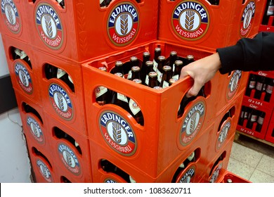 AACHEN, GERMANY - AUGUST 12, 2017: Erdinger beer crates. Erdinger is a brewery in Erding, Germany. Its best-known products are its namesake Weibiers (wheat beer)