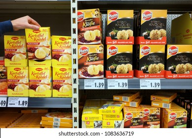 AACHEN, GERMANY - AUGUST 14, 2017: Supermarket interior, Knödel or Klöße are usually made from flour, bread or potatoes. Aisle contains Nestlé and Unilever brands side by side.