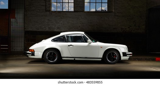 Aachen, Germany, August 16, 2013: Sideview shot of an historic Porsche 911 SC from 1981. The Porsche 911 SC had the wider body of the Porsche 911 Carrera. Also the 81-83 had side direction idicators.