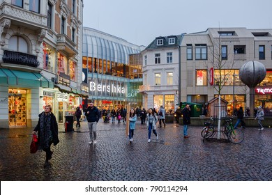 Aachen, Germany - December 21, 2017: Aquis Plaza mall in Aachen with unidentified people at dusk. Its a modern shopping mall with about 130 retail shops in the city center, opened 2015 to the public
