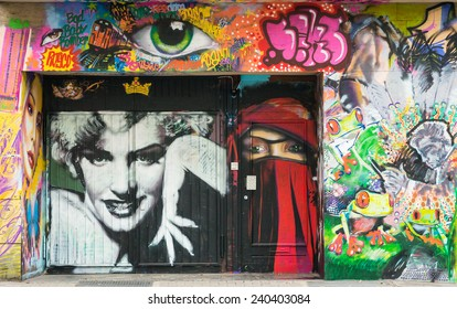 AACHEN, GERMANY - DECEMBER 6, 2014: A door covered by graffiti of Marilyn Monroe's portrait. Aachen is a city with population of 260,000 in North Rhine-Westphalia.