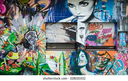 AACHEN, GERMANY - DECEMBER 6, 2014: A door covered by graffiti of women portrait. Aachen is a city with population of 260,000 in North Rhine-Westphalia.