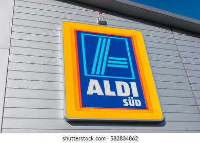 AACHEN, GERMANY FEBRUARY, 2017: Aldi sign (south division) against blue sky. Aldi is a leading global discount supermarket chain with almost 10,000 stores in 18 countries.