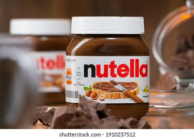 AACHEN, GERMANY - JAN 07, 2021: Pot of Nutella, the popular brand name of a sweetened hazelnut cocoa spread, introduced to the market in 1964 by Italian company Ferrero who celebrates 75 years