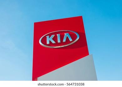 AACHEN, GERMANY JANUARY, 2017: Kia dealership sign against blue sky. Kia is South Korea's second-largest automobile manufacturer.