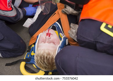 Aachen (Germany) july 09, 2017. Ambulance service 1. Paramedics are  preparing an injured person for the transport to the nearby hospital