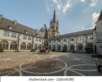 AACHEN, GERMANY - MAY 31, 2018. Courtyard and fountain in Domschatzkammer Aachen. Museum in Aachen,