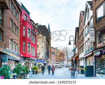 AACHEN, GERMANY - November 19, 2017: Tourists on foot Street in Aachen, Germany. Aachen was a residence of Charlemagne, and later the coronation place for German kings, Aachen, Germany