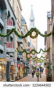 AACHEN, GERMANY - November 19, 2017: Tourists on foot Street in Aachen, Germany