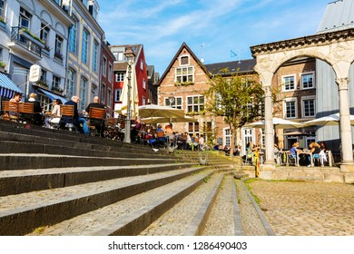 Aachen, Germany - October 12, 2018: square in the old town of Aachen with unidentified people. Aachen is a spa town in North Rhine-Westphalia and was residence of Charlemagne