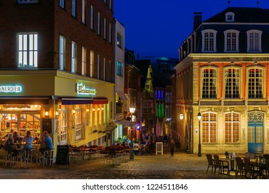 Aachen, Germany - October 15, 2018: night view in the old town of Aachen with unidentified people. Aachen is a spa town in North Rhine-Westphalia and was residence of Charlemagne