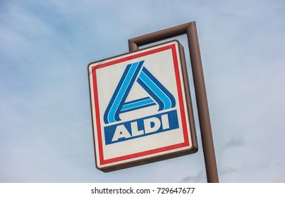 AACHEN, GERMANY OCTOBER, 2017: Aldi sign (north division) against blue sky. The German-based discount supermarket chain currently operates over 10,000 stores in 18 countries.