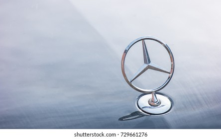 AACHEN, GERMANY OCTOBER, 2017: Mercedes Benz logo close up on a car grill. Mercedes-Benz is a German automobile manufacturer. The brand is used for luxury automobiles, buses, coaches and trucks.