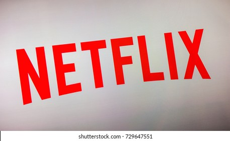 AACHEN, GERMANY OCTOBER, 2017: Netflix logo on a TV screen. Netflix is an entertainment company, specializes in and provides streaming media and video on demand online.