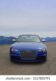 Aachen, Germany - September 15, 2019: Luxury blue motor car Audi on the road with the mountains in the background