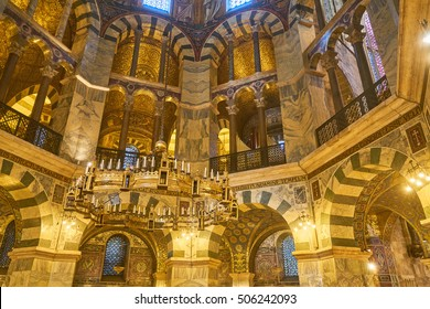 Aachen, Germany - September 25, 2016: Beautiful mosaics inside the octagon-shaped interior of the Aachen Cathedral, which is listed under the world heritage sites of the UNESCO