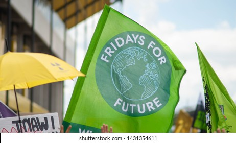 "Aachen, Nordrhein-Westfalen/Germany - 06.21.2019 during the biggest climate strike in Germany, protestors hold a flag with the sign of ""Fridays for Future"""