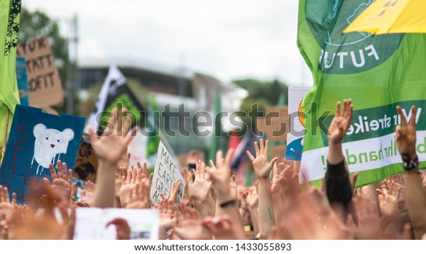 "Aachen, Nordrhein-Westfalen/Germany - 06.21.2019 ""Fridays for Future"" protestors hold up their hands, striking for more climate protection. The movement ""Fridays for Future"" founded by Greta Thunberg."