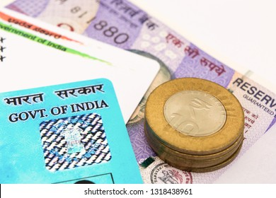 Aadhar card and pan card which are issued by Government of India as an identity card with Indian currency