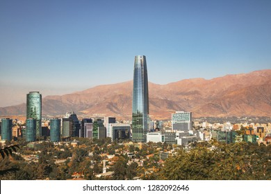 Aaerial view of Santiago skyline with Costanera skyscraper and Andes Mountains - Santiago, Chile