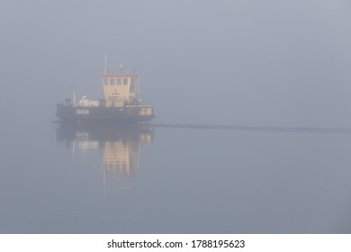 Aalborg, Denmark - Dec 26th 2019 - The old ferry from Aalborg to Egholm moves through the mist