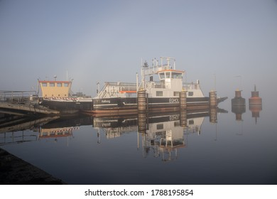 Aalborg, Denmark - Dec 26th 2019 - The old and the new ferries to Egholm docked at the Aalborg side