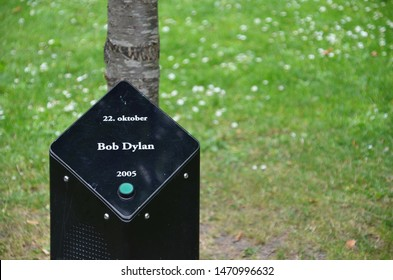 Aalborg / Denmark - July 28 2019: Bob Dylan singing tree in Park of music in Kildeparken. Trees are planted by famous musicians, singers or bands accompagnied by black pillars playing their songs