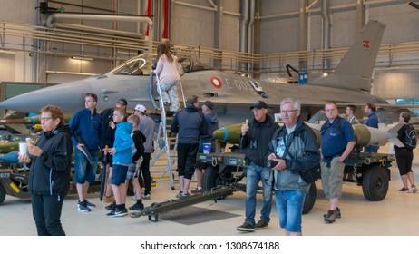 AALBORG, DENMARK - JUNE 10, 2018: Spectators inspect an F-16 on display at Danish Airshow 2018, June 10, 2018, Aalborg Airbase, Aalborg, Denmark.
