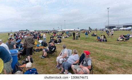 AALBORG, DENMARK - JUNE 10, 2018: Spectators awaits fighters and helicopters to take to the skies at Danish Airshow 2018, June 10, 2018, Aalborg Airbase, Aalborg, Denmark.