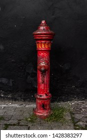 Aalborg, Denmark - June 19 - Old red fire hydrant with graffiti paint on