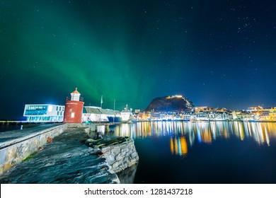 Aalesund city at night with Aurora