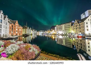 Aalesund  city at night under the aurora