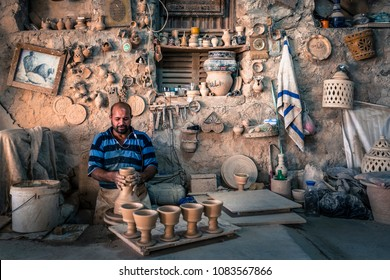 A'ALI, BAHRAIN - September 22: Potter in a pottery workshop in the village A'ali, Bahrain.September 22nd 2016 in A'Ali, Kingdom of Bahrain, Muddle East