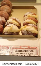 Aalsmeer, the Netherlands - November 7th 2018:Oliebollen, traditional Dutch sweet food for New Year's eve in the Netherlands, made of dough, like donuts. Dutch text on tags: type of food and price