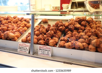 Aalsmeer, the Netherlands - November 7th 2018:Oliebollen, traditional Dutch sweet food for New Year's eve in the Netherlands, made of dough, like donuts. Dutch text on tags: flavor and price