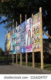 AALST, BELGIUM, 9 OCTOBER 2018: A billboard full of political candidates posters for the local elections in Flanders in Belgium. The elections took place on October 14 2018.