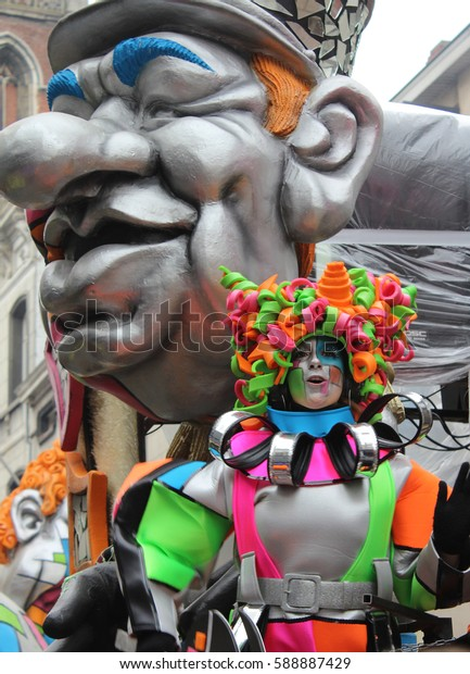 AALST, BELGIUM, FEBRUARY 26 2017: Colorfully dressed unknown female dancer during the annual carnival parade in Aalst, which is a UNESCO recognized event of Intangible Cultural Heritage.