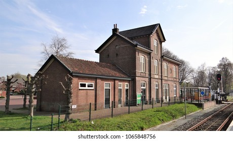 Aalten / Netherlands - April 10 2018: The small and old station building of the dutch village Aalten in the Achterhoek with a red signal.