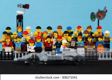 Aalter, Belgium, 21 august 2015: lego F1 race car passing lego figures on tribune. lego speed champions. race car moving